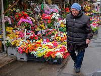 RIGA, LATVIA - CIRCA MAY 2014: Person walking in the exterior area of the Central Market in Riga