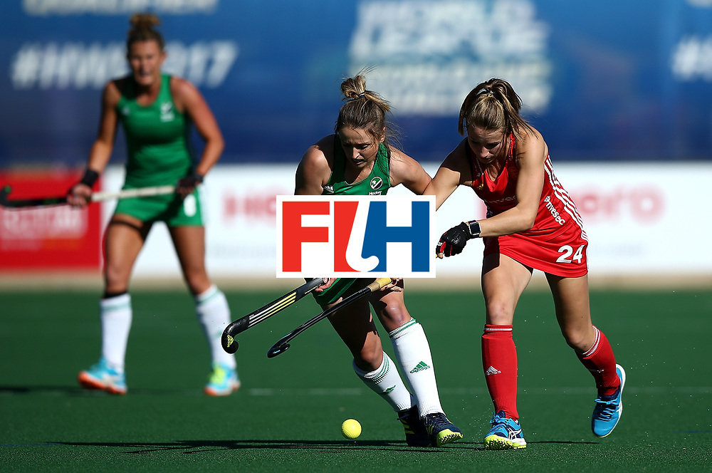 JOHANNESBURG, SOUTH AFRICA - JULY 16:  Gillian Pinder of Ireland battles with Shona McCallin of England during day 5 of the FIH Hockey World League Women's Semi Finals Pool A match between England and Ireland at Wits University on July 16, 2017 in Johannesburg, South Africa.  (Photo by Jan Kruger/Getty Images for FIH)