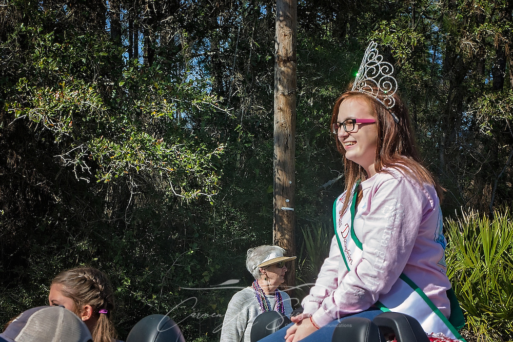 Savannah Johnson, 2016 Miss Dauphin Island, rides in Dauphin Island's first People's Parade during Mardi Gras, Feb. 4, 2017, in Dauphin Island, Alabama. French settlers held the first Mardi Gras in 1703, making Mobile's celebration the oldest Mardi Gras in the United States. The first parade of the season is traditionally held on Dauphin Island and draws thousands. (Photo by Carmen K. Sisson/Cloudybright)