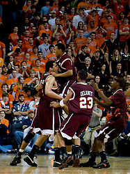 Virginia Tech celebrates after a last second game winning shot in overtime by Virginia Tech forward Deron Washington (13).  The Virginia Cavaliers men's basketball team fell to the Virginia Tech Hokies 70-69 in overtime at the John Paul Jones Arena in Charlottesville, VA on January 16, 2008.