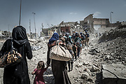 Civilians flee the Old City of Mosul as the fighting to liberate the remaining pocket of ISIS-held territory continues, July 4, 2017. <br />