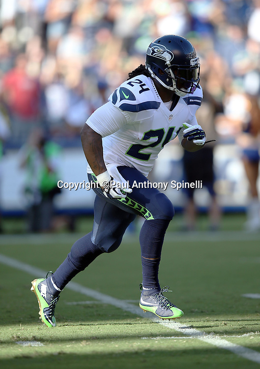 Seattle Seahawks running back Marshawn Lynch (24) makes a move in the first quarter during the 2015 NFL preseason football game against the San Diego Chargers on Saturday, Aug. 29, 2015 in San Diego. The Seahawks won the game 16-15. (©Paul Anthony Spinelli)
