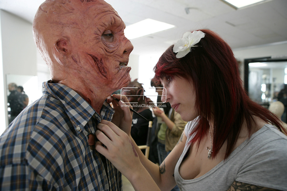 23rd October 2008, Los Angeles, California. Extreme Makeover!  Students at the Cinema Makeup School in Hollywood California, graduate from a special effects make-up course.  In this part of the course, movie industry hopefuls learn to design and create latex masks over a period of four weeks, before demonstrating their competence by transforming models into drag queens, aliens and monsters in only eight hours. Pictured is: Giovanni Fernandez (25) as a zombie farmer. PHOTO © JOHN CHAPPLE / REBEL IMAGES.john@chapple.biz    www.chapple.biz.(001) 310 570 9100.