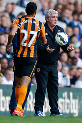 Hull City Manager Steve Bruce throws the ball to Ahmed Elmohamady - Photo mandatory by-line: Rogan Thomson/JMP - 07966 386802 - 16/05/2015 - SPORT - FOOTBALL - London, England - White Hart Lane - Tottenham Hotspur v Hull City - Barclays Premier League.