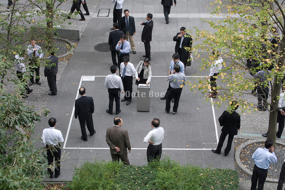 businesspeople standing at a smoking destination area
