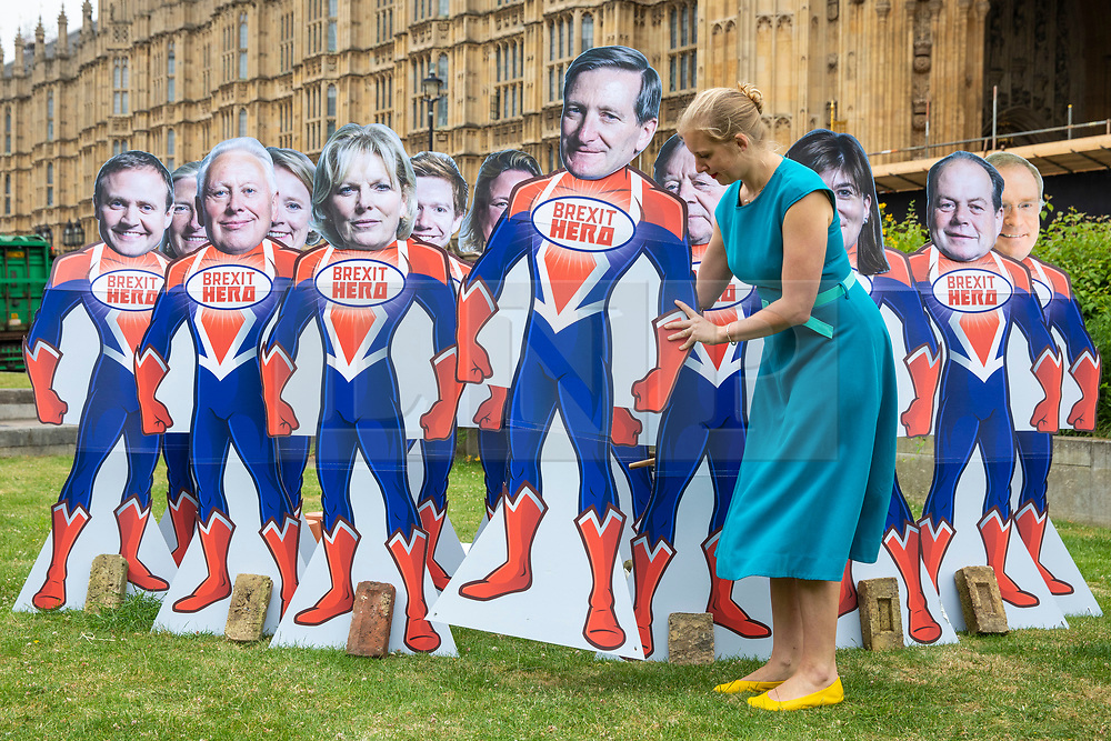 © Licensed to London News Pictures. 20/06/2018. London, UK. Campaigners from Avaaz arrange 'Brexit Hero' superhero models of the Tory Rebel MPs as Parliament prepares to vote on the EU Withdrawal Bill. Photo credit: Rob Pinney/LNP