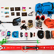 Jay Goodrich's skiing equipment laid out on white seamless.