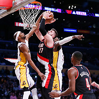 26 March 2016: Portland Trail Blazers center Jusuf Nurkic (27) is blocked by Los Angeles Lakers forward Corey Brewer (3) during the Portland Trail Blazers 97-81 victory over the Los Angeles Lakers, at the Staples Center, Los Angeles, California, USA.