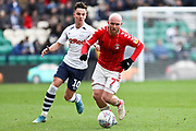 Charlton Athletic midfielder Jonathan Williams (7) challenged by Preston North End midfielder Josh Harrop (10) during the EFL Sky Bet Championship match between Preston North End and Charlton Athletic at Deepdale, Preston, England on 18 January 2020.