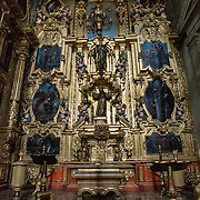 MEXICO CITY, MEXICO --One of the ornate chapels lining the main hall of the Metropolitan Cathedral. Built in stages from 1573 to 1813, the Mexico City Metropolitan Cathedral is the largest Roman Catholic cathedral in the Americas. It sits in the heart of the historic quarter of Mexico City along one side of the the Zocalo.