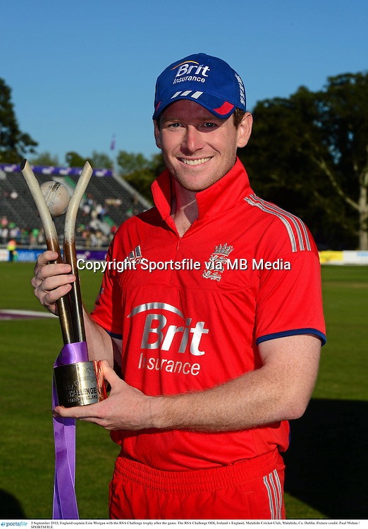 3 September 2013; England captain Eoin Morgan with the RSA Challenge trophy after the game. The RSA Challenge ODI, Ireland v England, Malahide Cricket Club, Malahide, Co. Dublin. Picture credit: Paul Mohan / SPORTSFILE