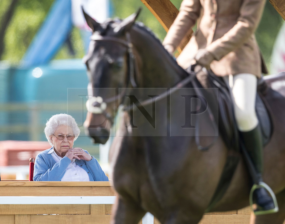 © Licensed to London News Pictures. 09/05/2018. Windsor, UK. Queen Elizabeth II watches a horse during a competition at the 75th Royal Windsor Horse Show . The five day event takes place in the grounds of Windsor Castle. The Queen and the Duke of Edinburgh usually attend. Photo credit: Peter Macdiarmid/LNP
