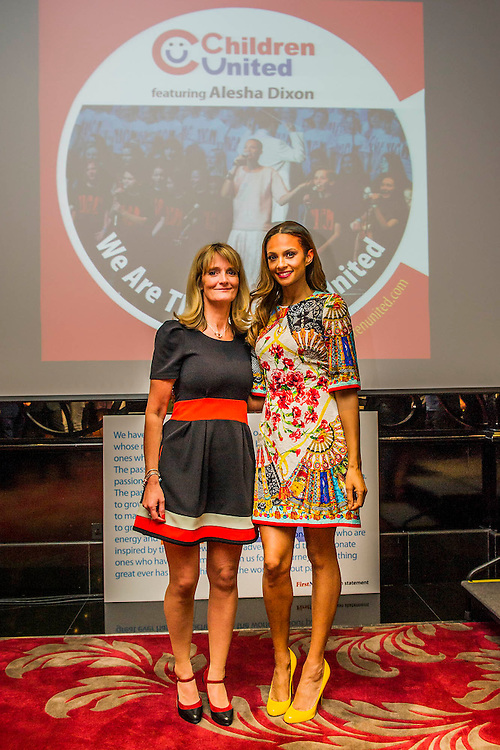 "Alesha Dixon (with Nicky Cox, editor of First News) launches Children United and the ""We Are The Children United"" single. Alesha is the most well-known name on the single, the first voice you hear on the song is that of 12-year-old Patience who lives in a children's home in Uganda after losing most of her family to AIDS. The pair are joined by thousands more children from countries as far flung as Kenya, Australia, India, USA, Uganda, The Netherlands and Norway who all feature on the Children United single. More countries and more children are joining the ""world's biggest pop group"" every day and posting their recordings on YouTube. The song was written by Barney Cox and produced by Nigel Wright.<br /> Around 10,000 children's voices are on the song including 6,500 children from the Voice In A Million choir<br /> who performed the song live at Wembley with Alesha in March.<br /> <br /> Children United is an online platform which will bring children together from across the globe to discuss the issues that matter to them, and provide them with the opportunity to have their voices heard. The three founding partner organisations are First News, Achievement for All, and Skoolbo. They have been working with Microsoft to support the web development and integration of Skype technology that will connect children across the world in face-to-face conversations. Save the Children are the charity's key NGO partner.<br /> <br /> The Children United website, which encourages children around the world to ""join-up"" and be heard, opens for<br /> registration on Wednesday (15 April) and goes fully live and interactive in September. The site will be moderated<br /> by schools around the world to ensure a secure environment for children to talk to each other safely."