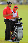 Alavaro Quiros and his caddie during the first round of the World Golf Championship Cadillac Championship on the TPC Blue Monster Course at Doral Golf Resort And Spa on March 8, 2012 in Doral, Fla. ..©2012 Scott A. Miller.