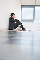 Despaired Businessman Sitting on Floor