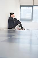 Despaired Businessman Sitting on Floor