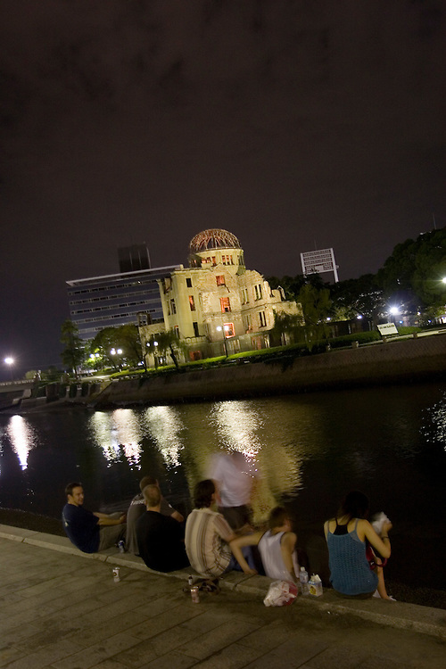 Hiroshima Young People meet  to sing  and hang out  on the  banks of the Motoyasu-Gawa river in View of the  A-bomb Dome.