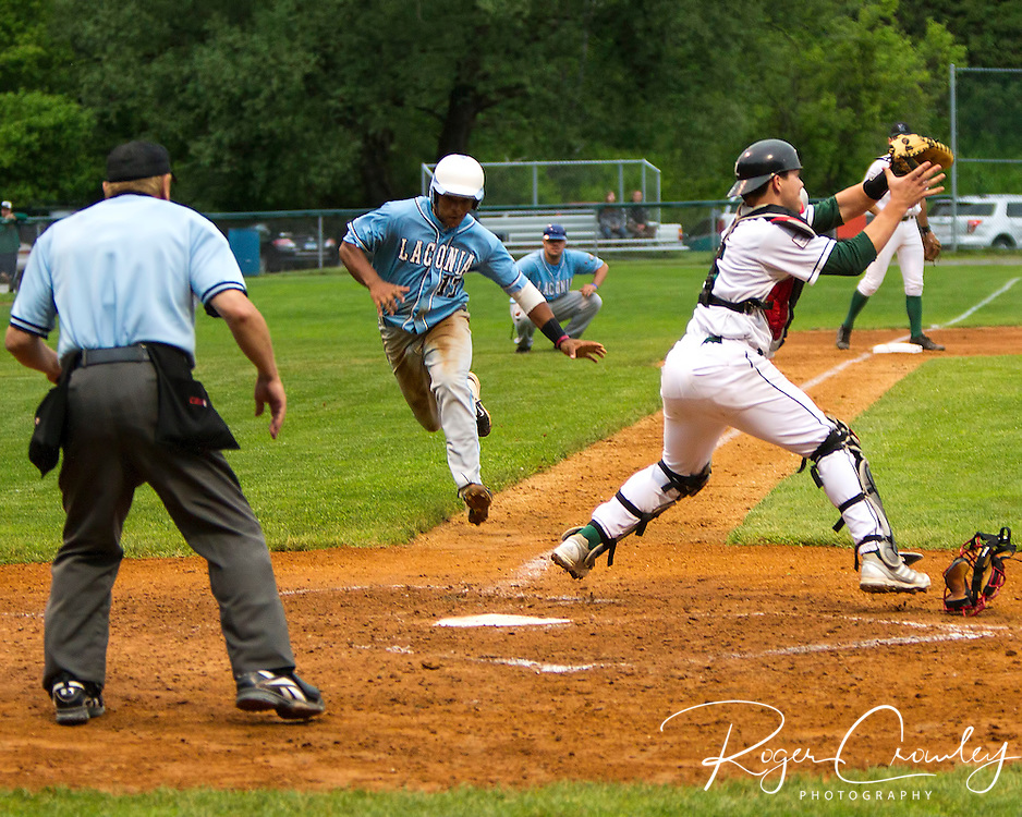 Mountaineer catcher Zach Soria (Louisville) tags Laconia's Kaleb Barlow (U West Florida) at the plate.