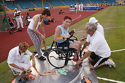 British Open Athletics Championships 2003 games; preparations for disabled athlete taking part in a discus event,