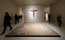 Cologne, Germany, Jan. 2012 - PICTURED: Decorative Flooring with an image of the Cosmos from the parish church of St. Pankratius, 1220/1230, terra cotta, Crucifix from Erp, Rhineland, 1st half, 12th century, in walnut...Its hard to say what makes more impact: the Kolumba museums vertiginous mix of ancient religious and modern secular artworks, or its astounding, vintage-2007 building from the Pritzker-winning Swiss architect Peter Zumthor. Shift your gaze from an oversize, late-12th-century carved ivory crucifix to a neighboring untitled sculpture by the great Joseph Beuys, then take in the spires of the Cologne Dom cathedral, artfully framed in a nearby floor-to-ceiling window (Kolumbastrasse 4; 49-221-933-193-32; kolumba.de). (Photo © Jock Fistick)