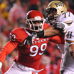 Oct 16, 2009; Piscataway, NJ, USA; Rutgers defensive end Jonathan Freeny (99) battles Pittsburgh offensive lineman Jason Pinkston (77) during first half NCAA football action in Pittsburgh's 24-17 victory over Rutgers at Rutgers Stadium.