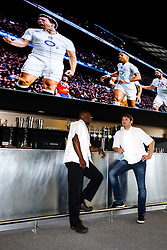 Chefs George Opondo and Josh Eggleton pose in front of the giant screen in the Ashton Gate Stadium Sports Bar & Grill ahead of the Rugby World Cup viewings to be held at the stadium - Photo mandatory by-line: Rogan Thomson/JMP - 07966 386802 - 15/09/2015 - SPORT - Ashton Gate Stadium - Bristol, England - Bristol Sport Bar & Grill World Cup Viewing Launch.