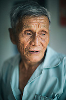 A portrait of Pham Dat, a survivor of the My Lai Massacre, at his home in central Vietnam.