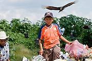 09 NOVEMBER 2004 - TAPACHULA, CHIAPAS, MEXICO: A child walks through the garbage in the municipal garbage dump in Tapachula, Chiapas, Mexico. About 130 people, the poorest of the poor in Tapachula, work in the dump picking through the garbage hoping to find tidbits they can use or sell to brokers who sit on the edge of the dump and resell the garbage. Most of the dump workers are Guatemalan migrants who crossed the border hoping, at one time, to get to the United States. Now they have settled for an existence on the very edge of Mexican society. PHOTO BY JACK KURTZ