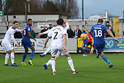 AFC Wimbledon striker James Hanson (18) with a shot during the EFL Sky Bet League 1 match between AFC Wimbledon and Rochdale at the Cherry Red Records Stadium, Kingston, England on 8 December 2018.