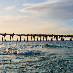 Pensacola Beach Gulf Pier at sunrise ultra high resolution panoramic photo. Pensacola Beach Florida is in the Emerald Coast of the Florida Panhandle in the Updated States of America. Panorama photo ratio is 1:5. Copyright ⓒ 2018 Paul Velgos with All Rights Reserved.