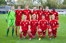 NEWPORT, WALES - Thursday, September 25, 2014: Wales' players line up for a team group photograph before the Under-16's International Friendly match against France at Dragon Park. Back row L-R: goalkeeper Scott Coughlan, Joe Lewis, Daniel Jefferies, Liam Angel, Ethan Ampadu, Theo Llewellyn, Ibi Sosani. Front row L-R: Ben Williams, Keiran Proctor, Sam Phillips, captain Matty Smith. (Pic by David Rawcliffe/Propaganda)