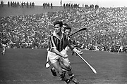 07/09/1969<br /> 09/07/1969<br /> 7 September 1969<br /> All-Ireland Senior Hurling Final: Kilkenny v Cork at Croke Park, Dublin.  <br /> P.O. Dulainne (Kilkenny forward) runs with the ball in his hand as Cork backs are close behind.