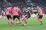 Hull City midfielder Sam Clucas (11)  gets his shot off among a lot of Southampton  players during the Premier League match between Hull City and Southampton at the KCOM Stadium, Kingston upon Hull, England on 6 November 2016. Photo by Simon Davies.