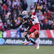 Jairo Arrieta, (left), D.C. United and Kemar Lawrence, New York Red Bulls, challenge for the ball during the New York Red Bulls Vs D.C. United, Major League Soccer regular season opening match at Red Bull Arena, Harrison, New Jersey. USA. 22nd March 2015. Photo Tim Clayton