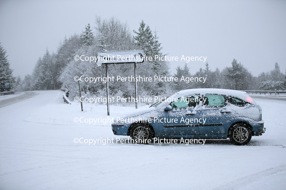 A snow covered vehicle crosses a deserted A9 north of Bruar and Calvine today near Trinafour as the first serious snowfall of the winter hits Perthshire...07.12.14<br /> Picture by Graeme Hart.<br /> Copyright Perthshire Picture Agency<br /> Tel: 01738 623350  Mobile: 07990 594431