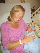 'I just saw it as babysitting': Woman, 49, gives birth to her GRANDSON after being surrogate for daughter with heart condition<br /> <br /> A 49-year-old northern Maine woman kept her word to act as a surrogate mother, and has given birth to her grandson.<br /> Linda Sirois of Madawaska, carried and delivered baby Madden Hebert, because her daughter Angel Hebert, 25, has a heart condition which would make pregnancy unsafe.<br /> Seven pound, 14 ounce baby Madden was born Aug. 13. His mother says he's 'eating like a champ and he doesn't fuss too much.'<br /> Sirois said she's offered for years to become a surrogate mother for Angel her if a doctor said she shouldn't become pregnant. Hebert, of Presque Isle, said she and husband Brian Hebert got that word last summer.<br /> Angel's egg, fertilized with Brian Hebert's sperm, was successfully implanted.<br /> 'It was all pretty simple as far as I was concerned,' said Linda to the Portland Press Herald.<br /> With her daughter's heart condition ruling out a 100 percent safe pregnancy, Hebert decided to ask her mother if she would be willing to act as a surrogate.<br /> 'It was pretty disappointing and we were pretty upset about it,' said Hebert. <br /> 'But we kind of had an idea that it was a possibility and, all along, my mother was saying, 'I'm here and I can carry for you.' I guess we didn't really take her seriously.<br /> 'I called her last summer and I'm like, 'So, you know that offer you've been offering? Is that offer still on the table?'<br /> Unfortunately most of the fertility clinics in the area turned Sirois down.<br /> Eventually the Reprodcutive Science Center in Lexington, Massachusetts accepted the nearly 50-year-old Sirois, on stringent conditions.<br /> Implanted with her daughter's fertilised egg, Sirois became pregnant during the first round of IVF treatment.<br /> Sirois described the pregnancy as the easiest of her previous three, with no morning sickness or complications.<br /> 'I didn't have any