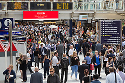 © Licensed to London News Pictures. 08/07/2015. London, UK. Liverpool Street station in London is busier than usual this evening before 6pm as City workers leave work earlier to catch the last tube trains. London transport workers begin strike action tonight, which will continue tomorrow. Photo credit : Vickie Flores/LNP