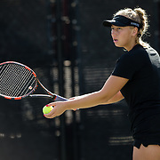 10 November 2017:  The San Diego State Aztecs women's tennis team hosts it's annual Fall Classic II. Mia Smith seen here about to serve the ball during a doubles match.<br /> www.sdsuaztecphotos.com