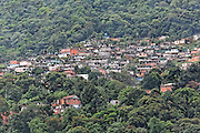 A favela developed horizontally into the jungle along the route of the old road used for constructing the highway. Cubatão, Brazil, 2008
