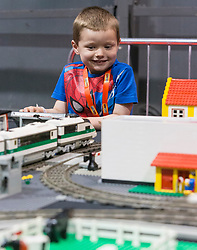 The SEC in Glasgow hosts Brick Live, the largest LEGO exhibition in the UK. Featuring models made up of over 6 million bricks, LEGO enthusiasts can build their own creations as well as admiring the models created by some of the leading designers including Scotland's Nick Clayton and Rocco Buttliere from Chicago.<br /> <br /> Pictured: Carter Brown (age 4) with a Fanzone Lego train-set