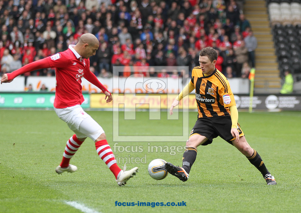 Picture by Richard Gould/Focus Images Ltd. 07710 761829.21/04/12.Corry Evans of Hull City and Adlene Guedioura of Nottingham Forest during the Npower Championship match at KC Stadium, Hull.