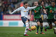 Zach Clough (Bolton Wanderers) takes a shot which is saved during the EFL Sky Bet League 1 match between Bolton Wanderers and Scunthorpe United at the Macron Stadium, Bolton, England on 31 December 2016. Photo by Mark P Doherty.