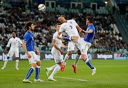 Kieran Gibbs of England heads a shot as Alessandro Florenzi of Italy challenges - Photo mandatory by-line: Rogan Thomson/JMP - 07966 386802 - 31/03/2015 - SPORT - FOOTBALL - Turin, Italy - Juventus Stadium - Italy v England - FIFA International Friendly Match.