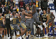 Kent sophomore guard Mitch Peterson celebrates with teammates after scoring the goahead basket with .3 seconds left on the clock against Western Michigan on Tuesday, Jan. 16, 2018.