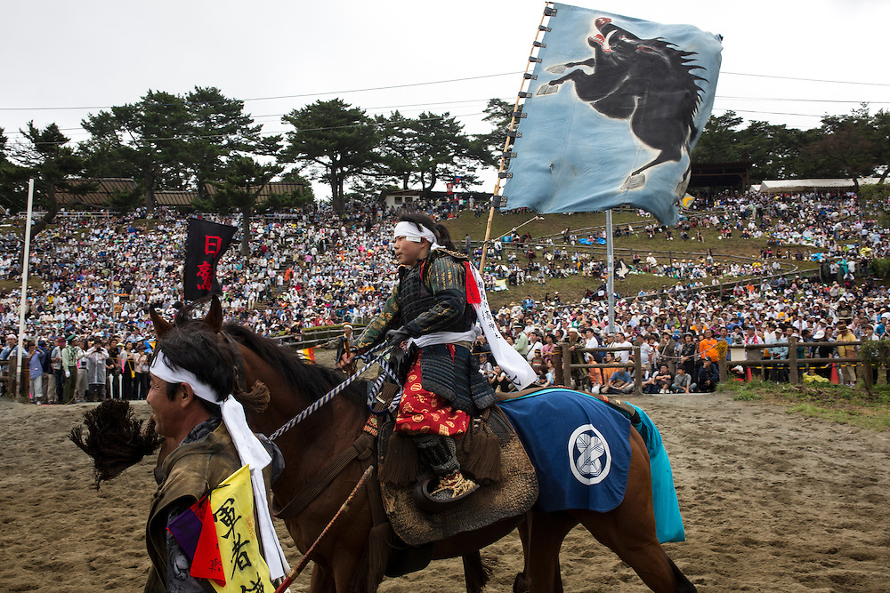 "MINAMISOMA, JAPAN - JULY 24 :  A samurai horsewoman is seen after completing the horse race ""Kacchu-keiba"" (armed horse race) during the Soma Nomaoi festival at Hibarigahara field on Sunday, July 24, 2016 in Minamisoma, Fukushima Prefecture, Japan. ""Soma-Nomaoi"" is a three day traditional festival that recreates a samurai battle scene from more than 1,000 years ago. The festival has gathered more than thousands visitors as Fukushima still continues to recovery from the 2011 nuclear disaster, the samurai warriors battles for recovery of the area. (Photo: Richard Atrero de Guzman/NURPhoto)"