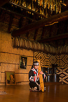 An Ainu woman plays a traditional stringed instrument - the Tonkori.