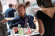 Event Photography images taken during the 2018 Podcast Day, held at The Black Diamond (Den Sorte Diamant) in Copenhagen, Denmark.<br /> <br /> A couple share a meal together.  <br /> <br /> © Event Photographer in Copenhagen Matthew James