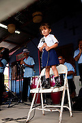 A young girl in a folk singing contest at the Maricao Coffee Festival in the highlands of Puerto Rico.