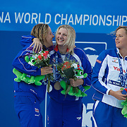 After seeing Federica Pellegrini of Italy break her World Record to win gold in the Women's 400m Freestyle, Rebecca Adlington, who won bronze congratulates team mate Joanne Jackson who finished second. at the World Swimming Championships in Rome on Sunday, July 7, 2009. Photo Tim Clayton.