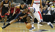 Miami Heat guard Garrett Temple, left, and Washington Wizards guard Shelvin Mack, right, go after a loose ball during the second half of an NBA preseason basketball game, Wednesday, Oct. 24, 2012, in Kansas City, Mo. (AP Photo/Colin E Braley)